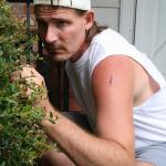 Man sneaking outside house.